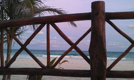 Nice wooden fence on the beach stock photography