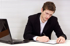 Nice worker with laptop Royalty Free Stock Photos