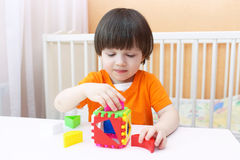 Nice 2 years boy plays educational toy Stock Image