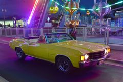 Nice yellow car in Saturday Nite Classic Car Show and Cruise at Old Town Kissimmee. stock image