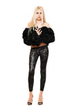 Nice young blonde in black coat and leggings Stock Images