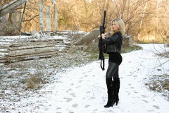 Nice young blonde with a gun Stock Image