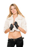 Nice young blonde in a white fur coat Stock Image