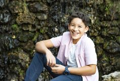 Nice young boy smiling in the park stock photography