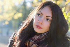 Nice young brunette in autumn park Stock Image