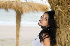 Nice young brunette on a beach Stock Photos