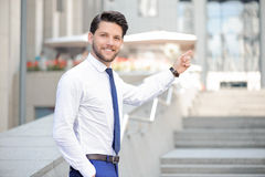 Nice young  businessman pointing up Royalty Free Stock Photo