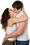 Nice young couple. Hugging and kissing. Isolated on white Royalty Free Stock Image