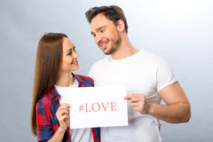 Nice young couple holding shit of paper Stock Photography