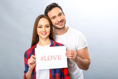 Nice young couple holding shit of paper Royalty Free Stock Image