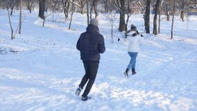 Nice young couple running in the winter forest.  stock video footage