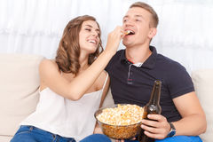 Nice young couple sitting on the couch Stock Photos