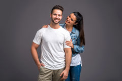 Nice young couple in the studio. A beautiful young couple hugging and holding each other in the studior Royalty Free Stock Photo