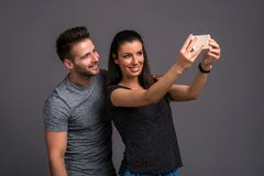Nice young couple in the studio Stock Photos