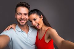 Nice young couple in the studio Royalty Free Stock Photos