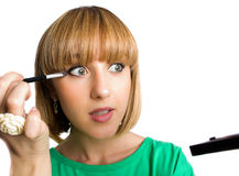 Nice young female with make-up brush isolated Royalty Free Stock Photo