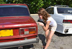 Nice young girl at a car Stock Photo