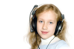 Nice young girl with headset Royalty Free Stock Image