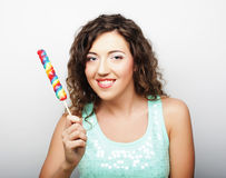 Nice young girl with lolipop Royalty Free Stock Images