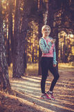 Nice young girl on morning jog in a summer forest Stock Image