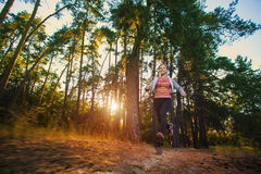 Nice young girl on morning jog in a summer forest Stock Images