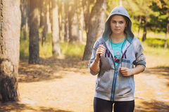 Nice young girl on morning jog in a summer forest Royalty Free Stock Photography