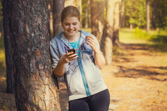 Nice young girl on morning jog in a summer forest Royalty Free Stock Image