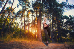 Nice young girl on morning jog in a summer forest Stock Photo