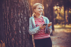 Nice young girl on morning jog in a summer forest Royalty Free Stock Images