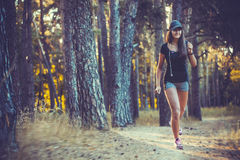 Nice young girl on morning jog in a summer forest Royalty Free Stock Photo