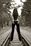 Nice young girl on a railroad Stock Image