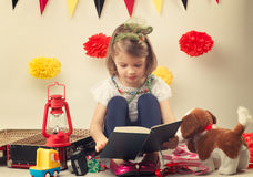 Nice young girl reading a book Stock Image