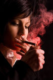 Nice young girl is smoking Stock Photo