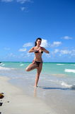 Nice young girl is standing close to ocean Royalty Free Stock Images