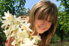 Nice young girl in white lilies Royalty Free Stock Photos