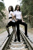 Nice young girls on a rail road Royalty Free Stock Images
