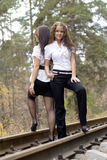Nice young girls on a rail road Stock Image