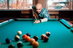 Nice young guy plays pool billiards Stock Image