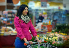 Nice Young Lady at the Supermarket Stock Images