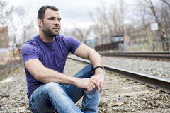 Nice young man portrait on the railroad. A nice young man portrait on the railroad Stock Photo