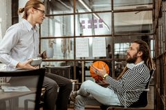 Nice young men having a break from work. Time for lunch. Nice young men talking to each other while having a break from work royalty free stock image