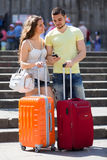 Nice young travellers finding path with smartphone Stock Images