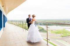 Nice young wedding couple outdoors Royalty Free Stock Image