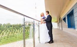 Nice young wedding couple outdoors Stock Image