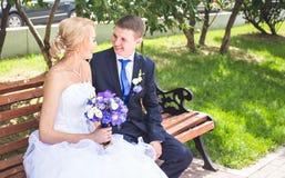 Nice young wedding couple outdoors Stock Photo