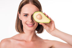 Nice young woman with avocado Stock Photography