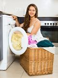 Nice young woman with clothes near washing machine Royalty Free Stock Photo