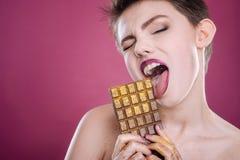 Nice young woman eating chocolate Stock Photo