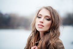 Nice young woman fashion model outdoors royalty free stock photos