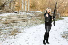 Nice young woman with a gun Royalty Free Stock Photo